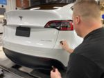 Installing Gyeon Mohs ceramic coating on Tesla Model Y rear bumper
