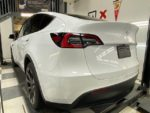 Tesla Model Y driver's side rear angle with ceramic coating